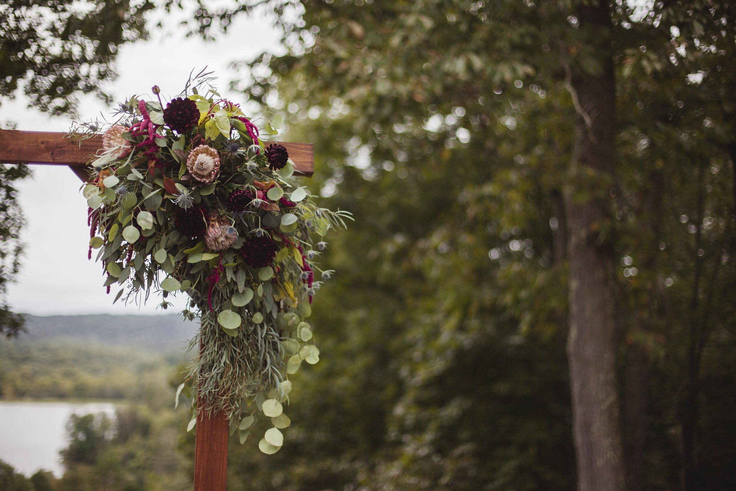 floral arch at wedding at lake upper arlington ohio photographer