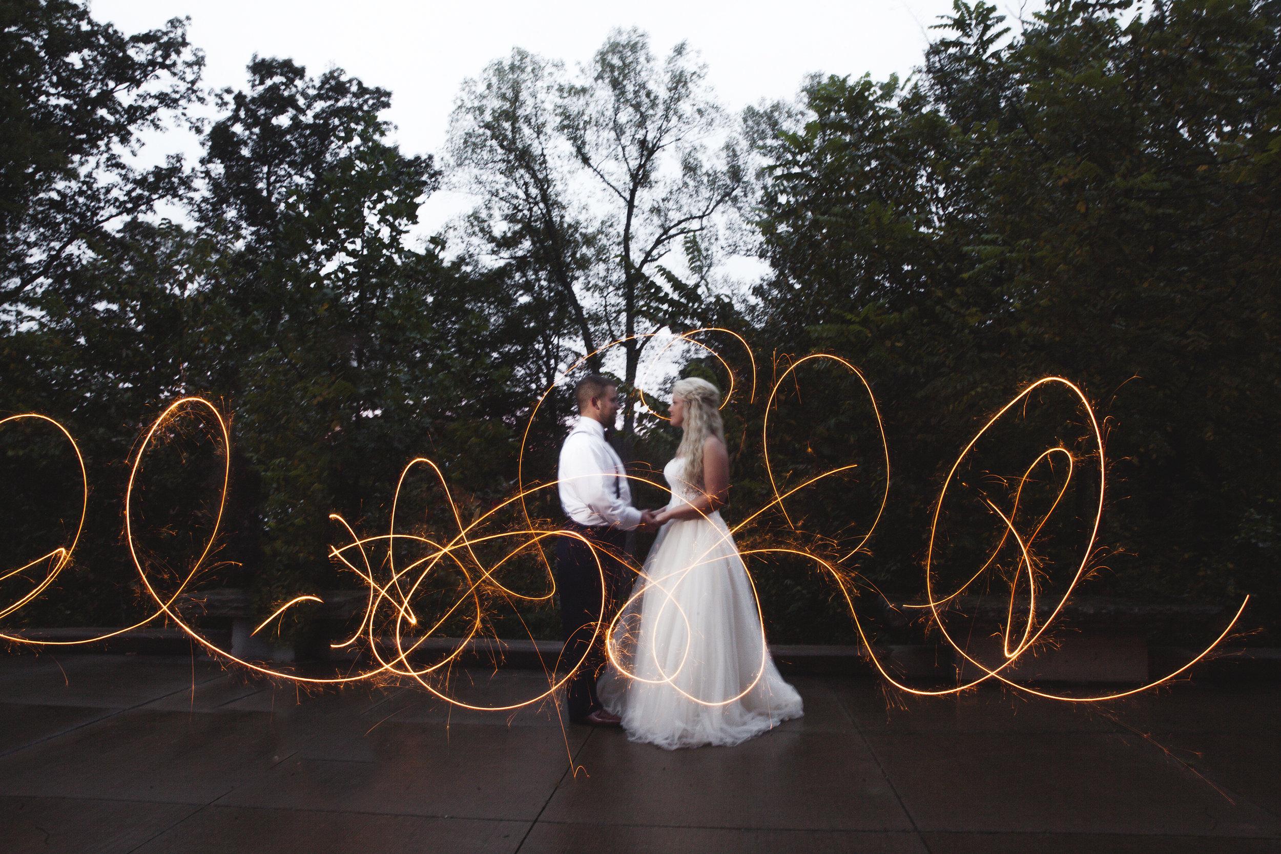 Writing with sparklers on wedding day