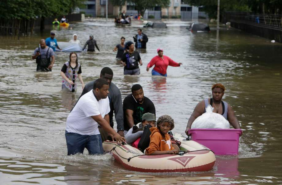 "Hurricane Harvey has caused historic flooding. Thousands have been displaced. You can be a ""helper."" Photo credit: Houston Chronicle"