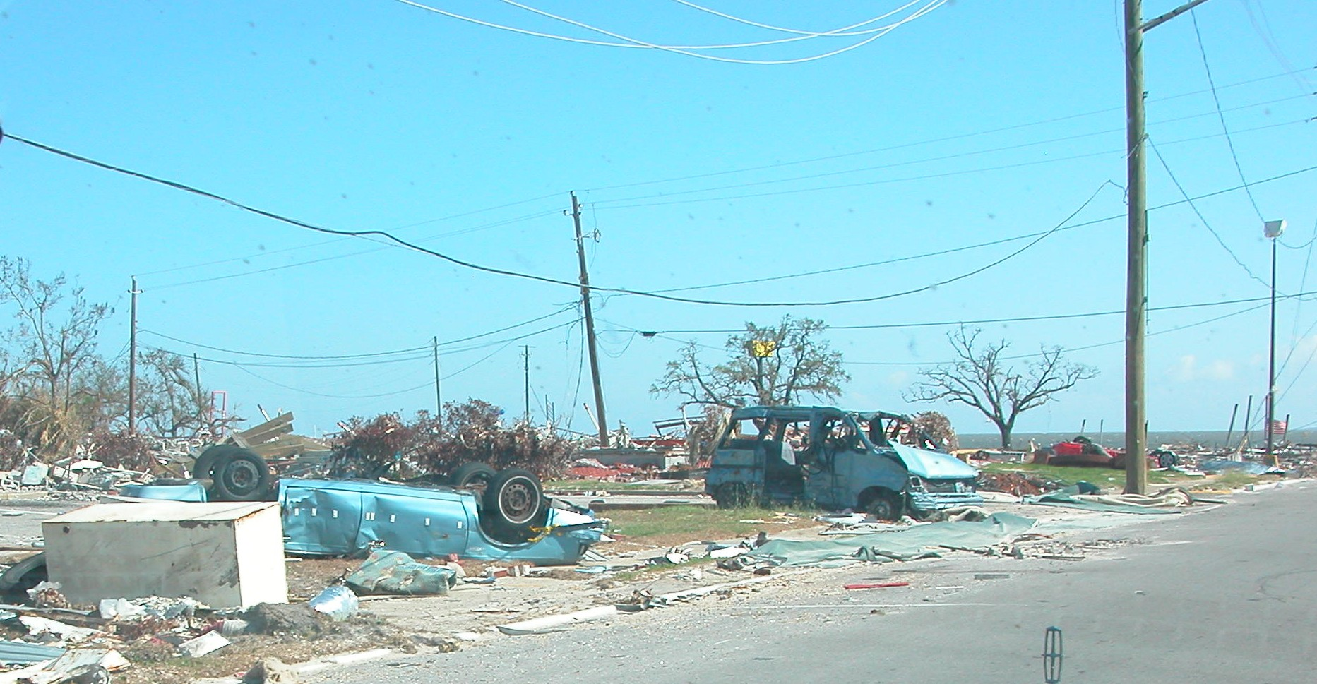 3. Boats were flung inland. Cars were toppled and mangled. Photo taken in Pass Christian, Mississippi.