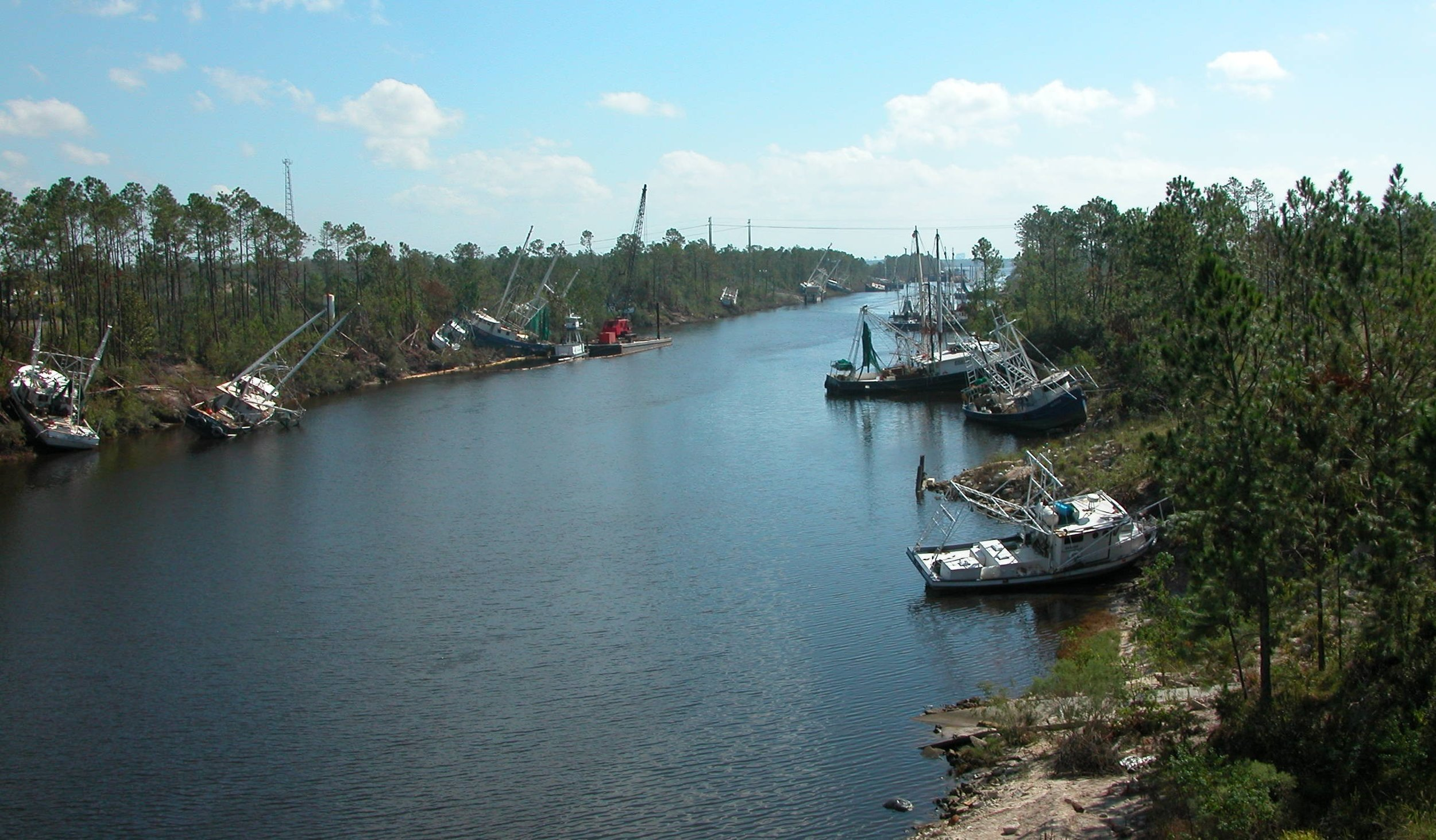 "5. Photo of Gulfport commercial fishing boats ""tossed"" here and there along the shores."