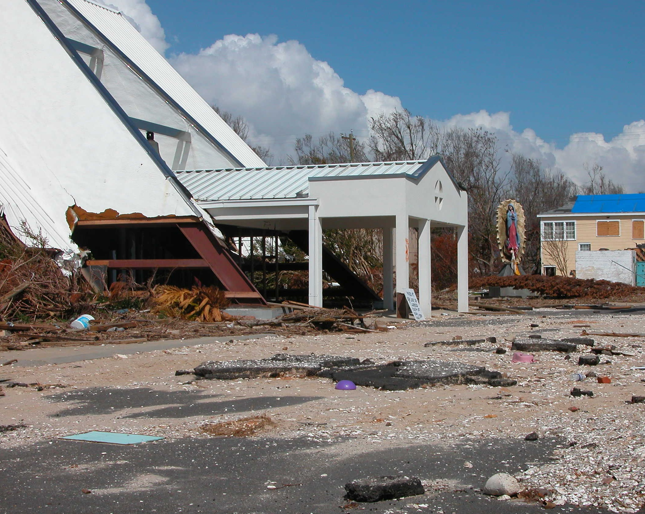 """10. """"The Catholic Church in Pass Christian had been torn apart by the wind and water, yet a shrine of Mary had been spared. There wasn't a scratch or mark on her."""" - David Aft"""