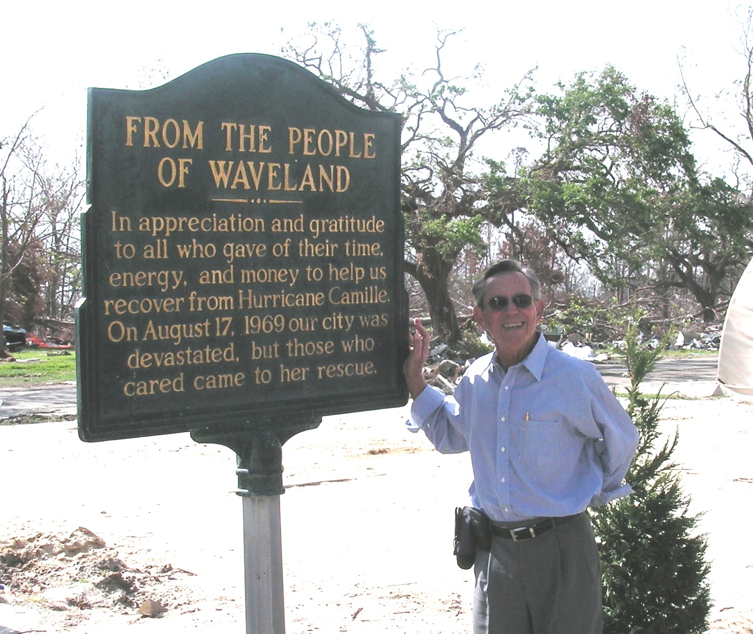 15. Norris Little poses next to a marker thanking volunteers and donors for helping the Waveland community rebuild after the Hurricane Camille disaster in 1969.