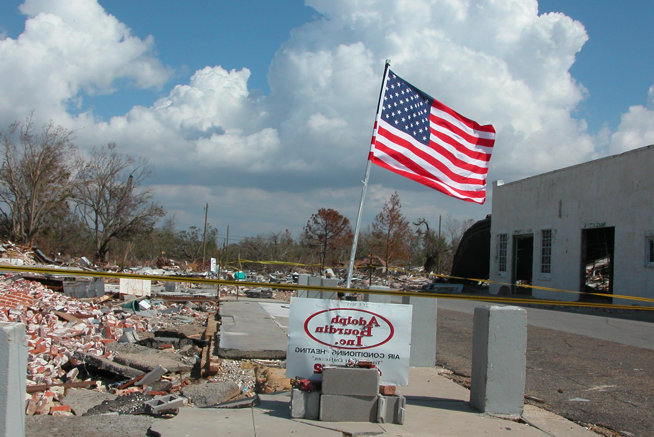 20. Residents of the coastal region placed an American flag near the debris field as an enduring symbol of hope.