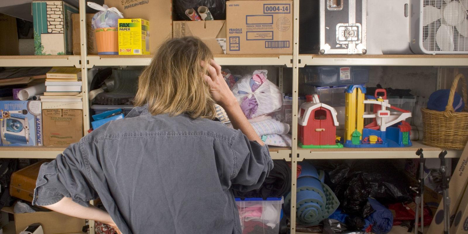landscape-1471628212-woman-garage-mmessy-shelves-clutter (1).jpg