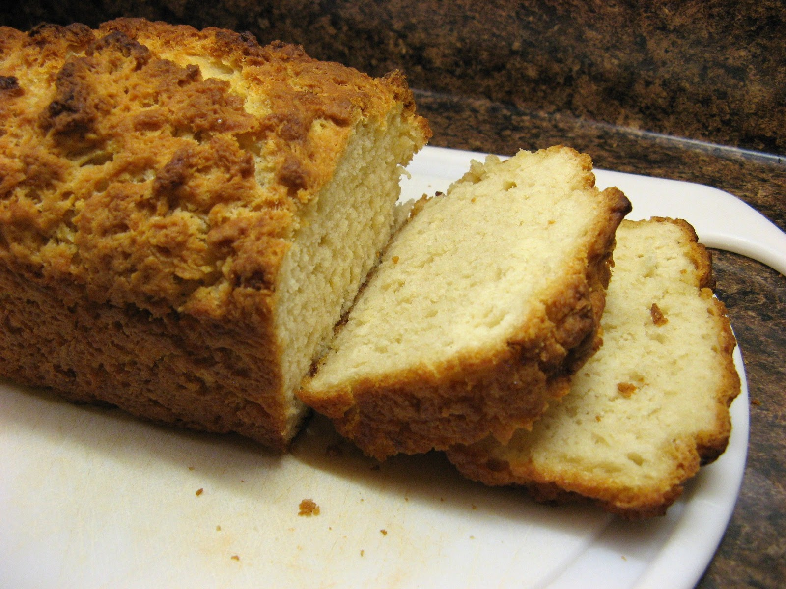 3 Cups flour – sifted!  3 tsp baking powder (omit if using Self-Rising flour)  1 tsp salt (omit if using Self-Rising flour)  ¼ cup sugar  1(12oz) can of beer  ½ cup melted butter  Preheat oven to 375 degrees. Mix dry ingredients and beer. Pour into a greased loaf pan. Bake 1 hour, remove from pan and cool for at least 15 minutes.  Notes: This recipe makes a very hearty bread with crunchy, buttery crust. If you prefer softer crust, mix the butter into the batter instead of pouring it over the top.  If using non-alcoholic beer, add a packet of Dry Active Yeast or 2 tsp bread machine yeast for proper rise.
