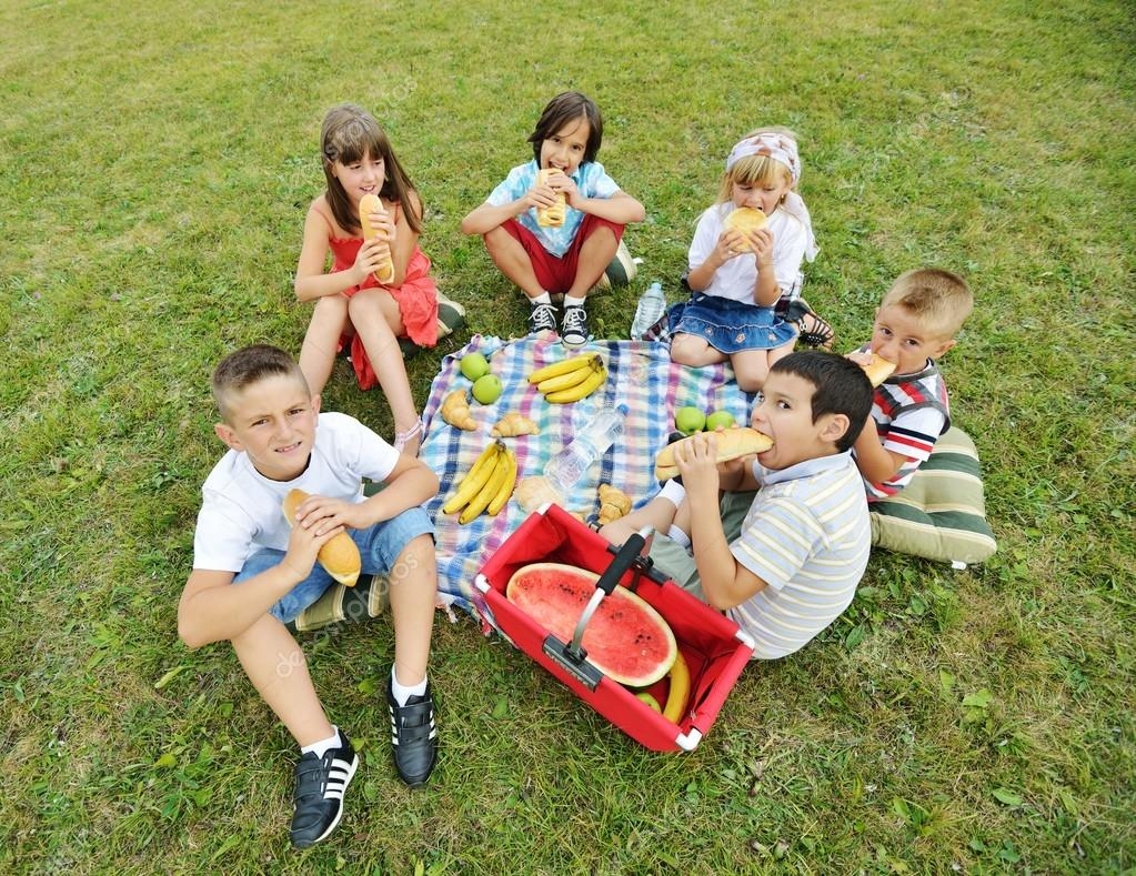 depositphotos_98579324-stock-photo-children-having-picnic-on-meadow.jpg