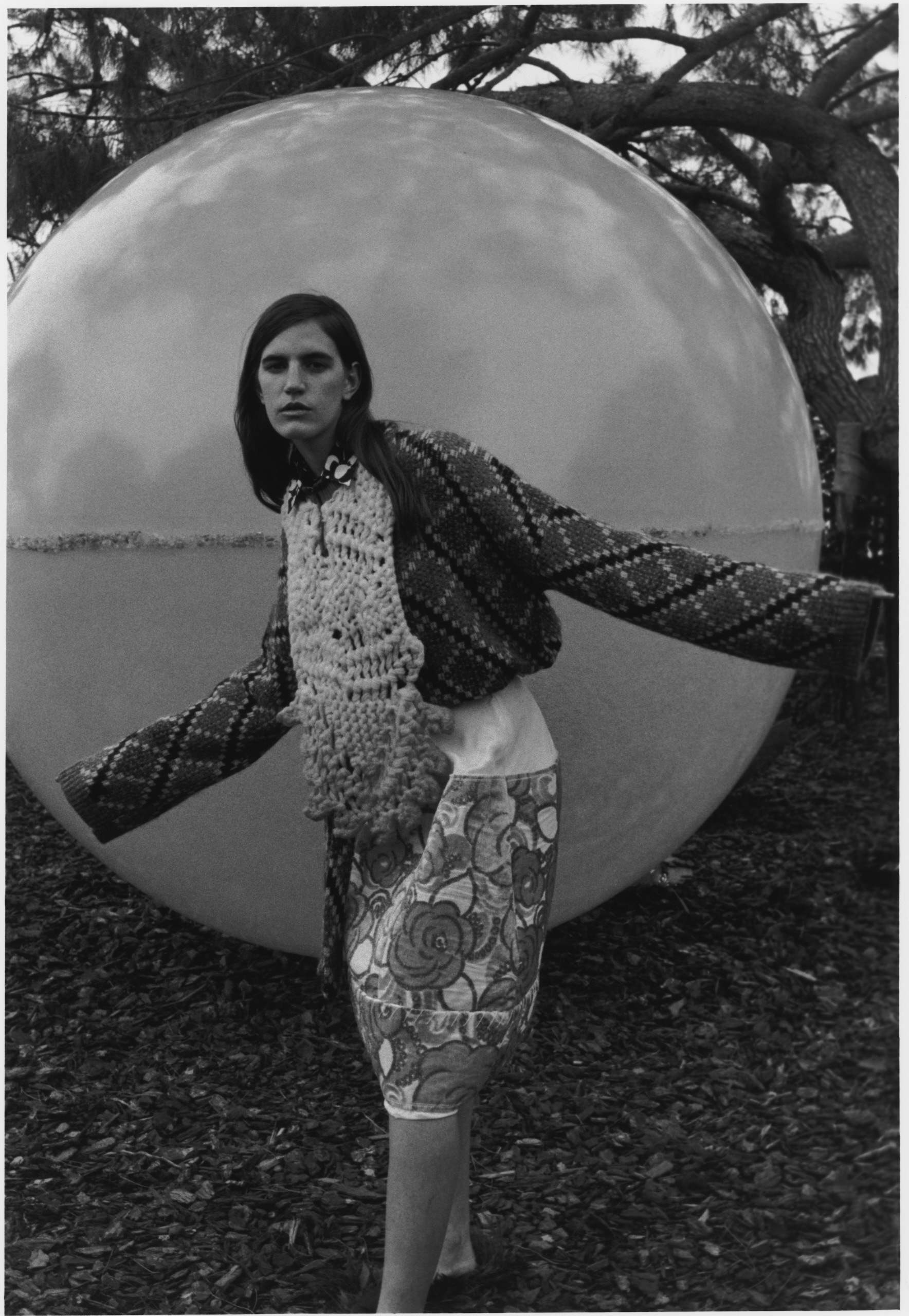 Sweater by Loewe. Shirt by Katharine Hamnett. Bib by Congregation. Skirt by Marni. 'The Sphere 3D Spectrum', by Clifton Mahangoe.  Photography: Jack Symes. Fashion: Marianthi Hatzikidi