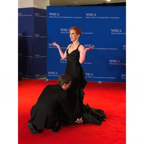 Comedian Kathy Griffin has her dress adjusted by boyfriend Randy Bick. (Rebecca Gibian/RealClearLife)