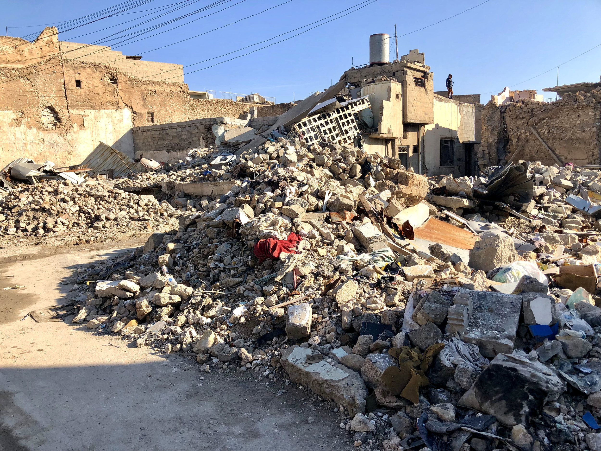 A pile of rubble across the street from the Great Mosque of al-Nuri. November, 2018. (Rebecca Gibian)