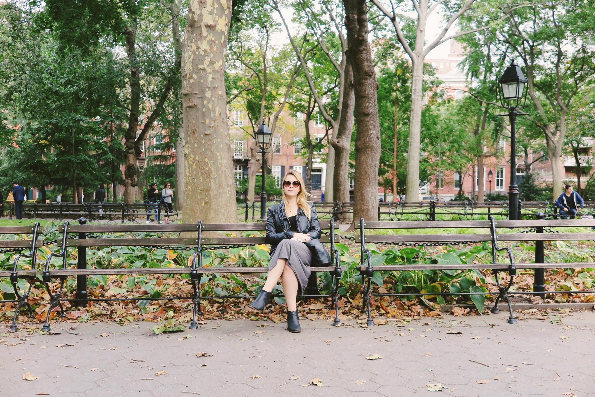 travel-green-new-york-city-washington-park-black-leather-jacket-gray-skirt-blonde-woman-park-bench.JPG