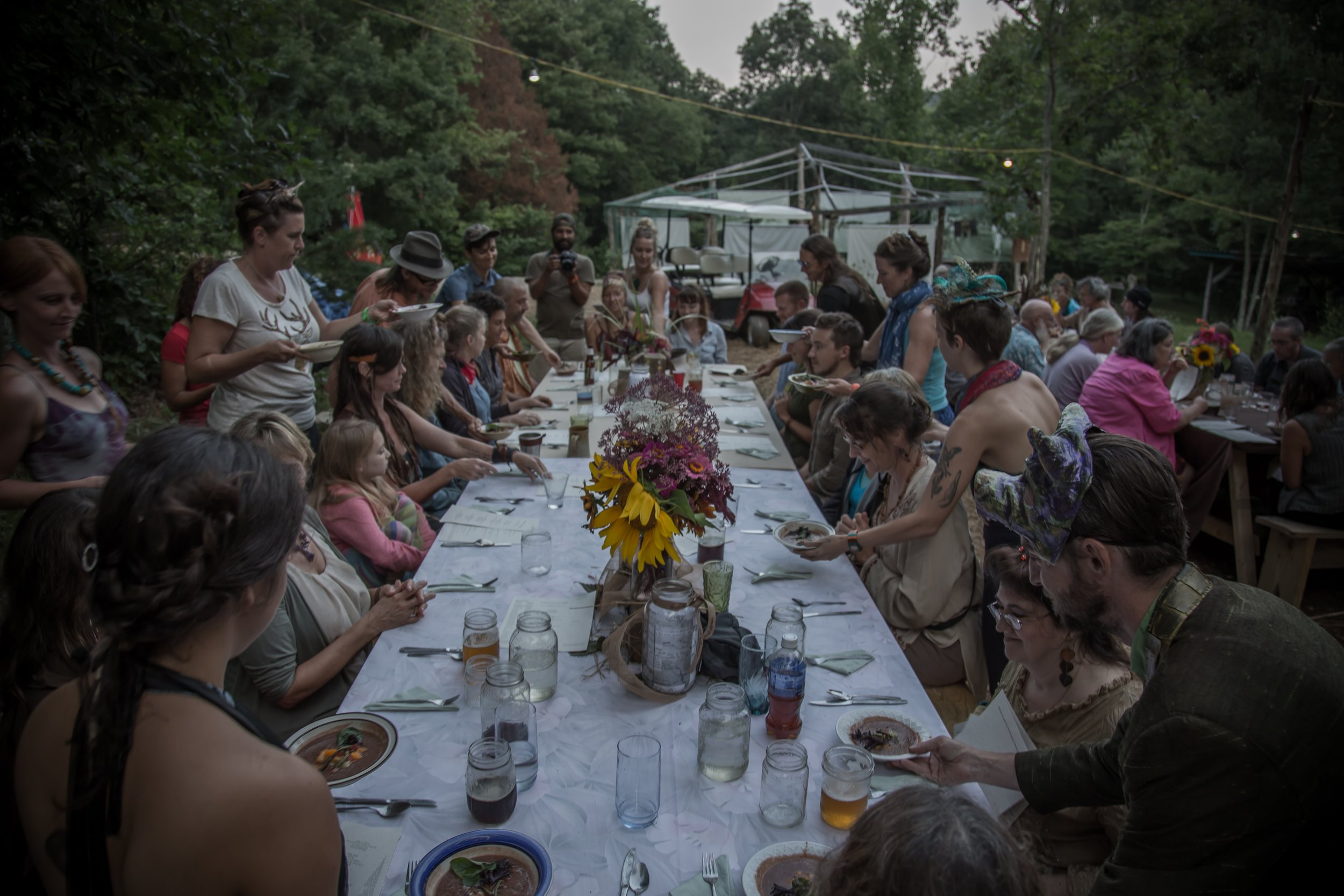 Over 100 people were served a farm-fresh outdoor community meal as part of Land, Water, Food, Story in 2014. (photo by Melisa Cardona)