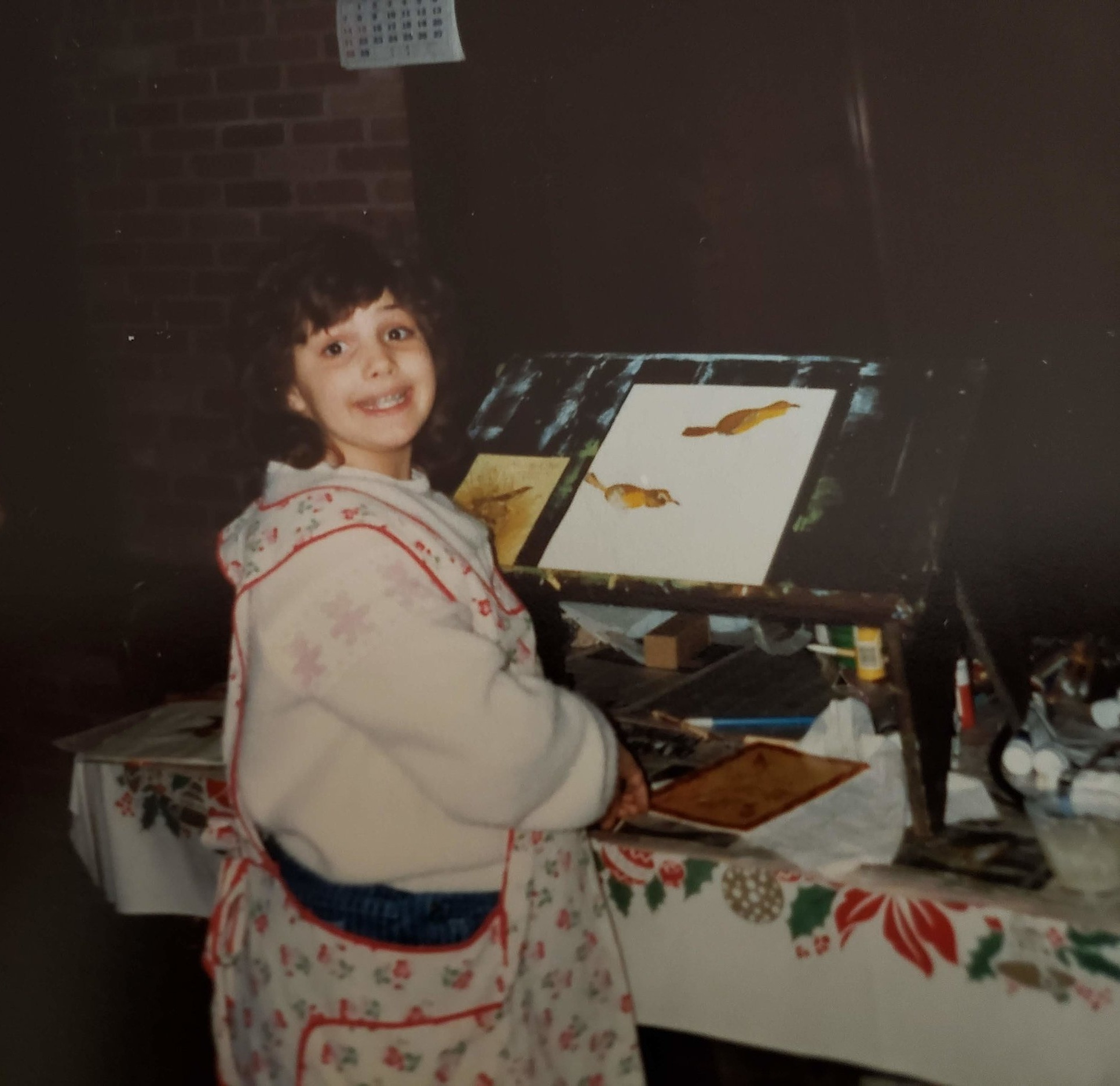 Me as a budding artist in my grandparents basement wearing my Mama's apron.