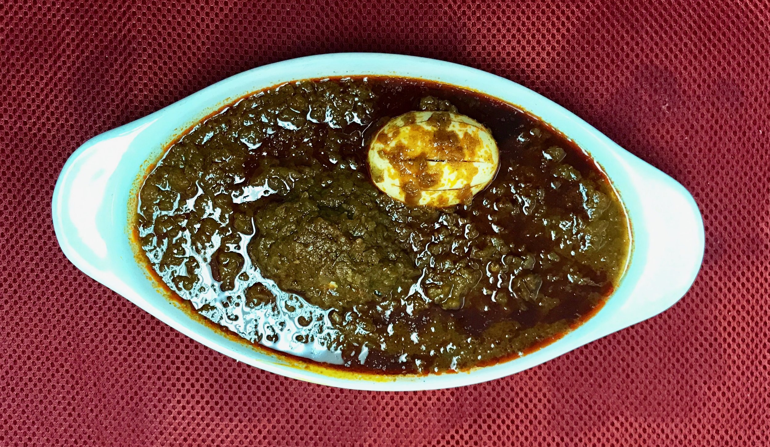 DORO WOT (SPICY CHICKEN)   Exquisitely flavorful chicken and egg simmered in butter and authentic Ethiopian herbs and spices ( kibbe )