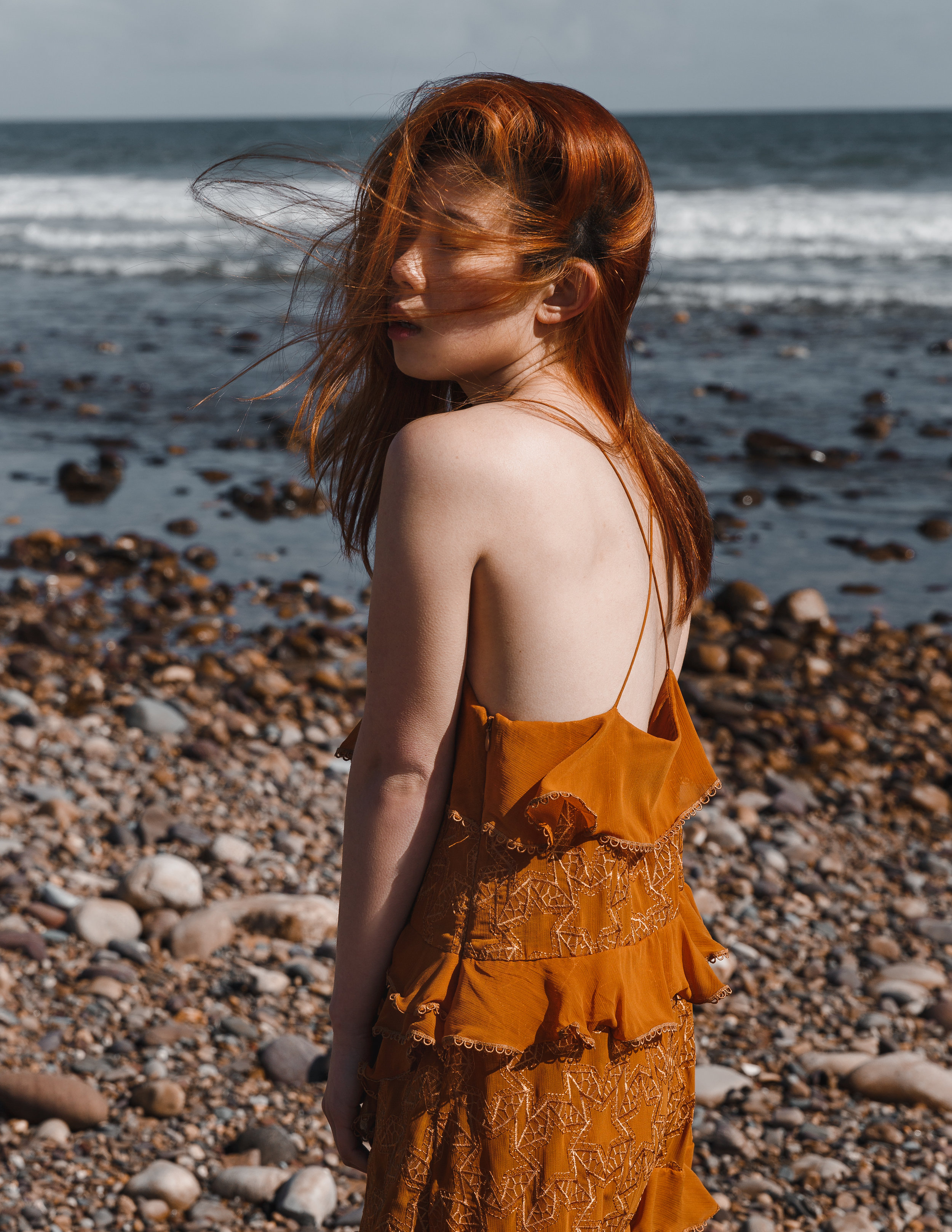 On the Rocks - Fashion editorial printed in Volant Magazine October 2018.Model: Nicole FangHMUA: Zoe PapanikolaouClothing supplied by: What's Mine is Yours HireCreative and Photography: By Kim Fisher