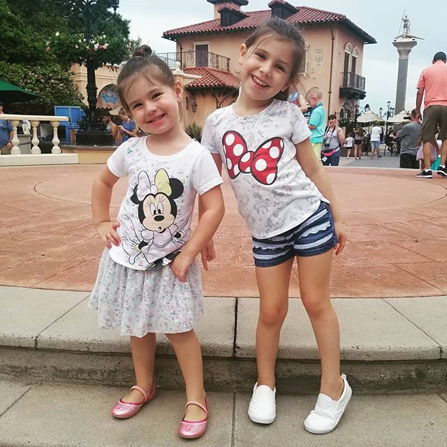 These two littles make every day brighter. . . . #summer #summernights #floridagirls #floridafun #sisters #disney #epcot #gadourygirlslovesdisney