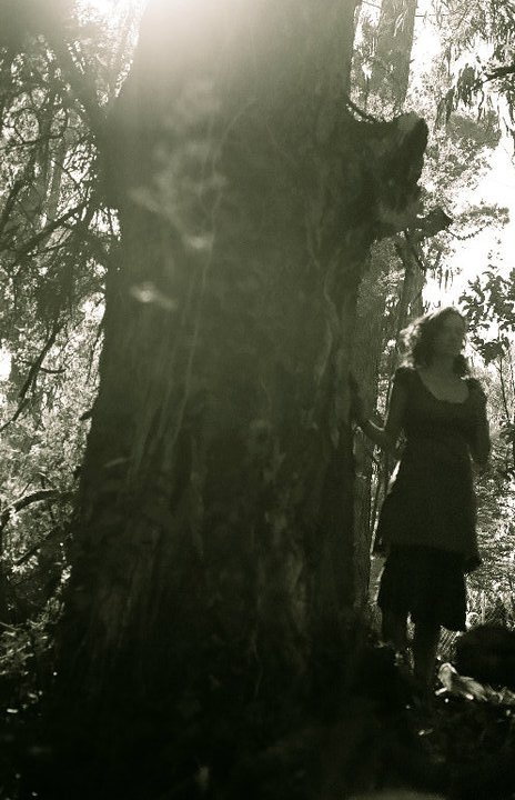 Woman standing in the trees, Golden Gate Park