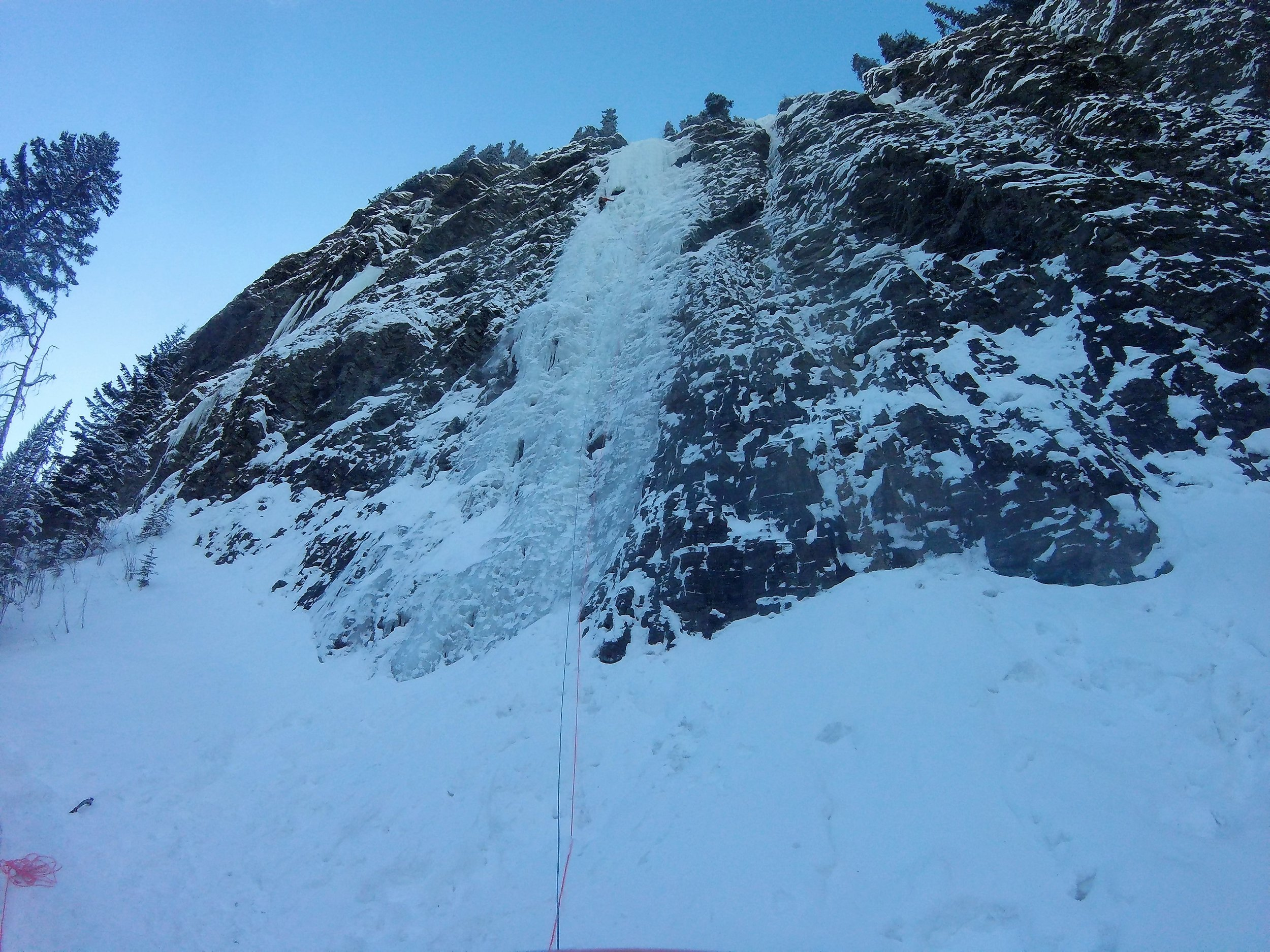 Moonlight (100m, WI4+). James heading to the ice cave which marks the end of the first pitch.