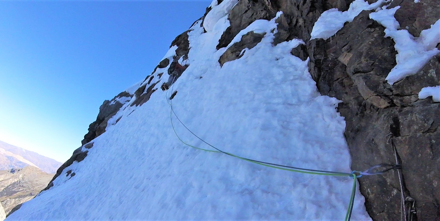 Renato approaching the crux of the climb, a fifteen meter section of vertical rock and snow with poor protection.