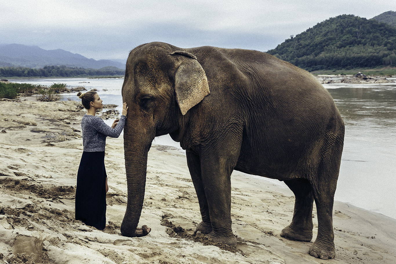 Pictured: Melissa Findley with Moukhao, a 38 year old female Asian elephant who was rescued from the logging industry in Laos.