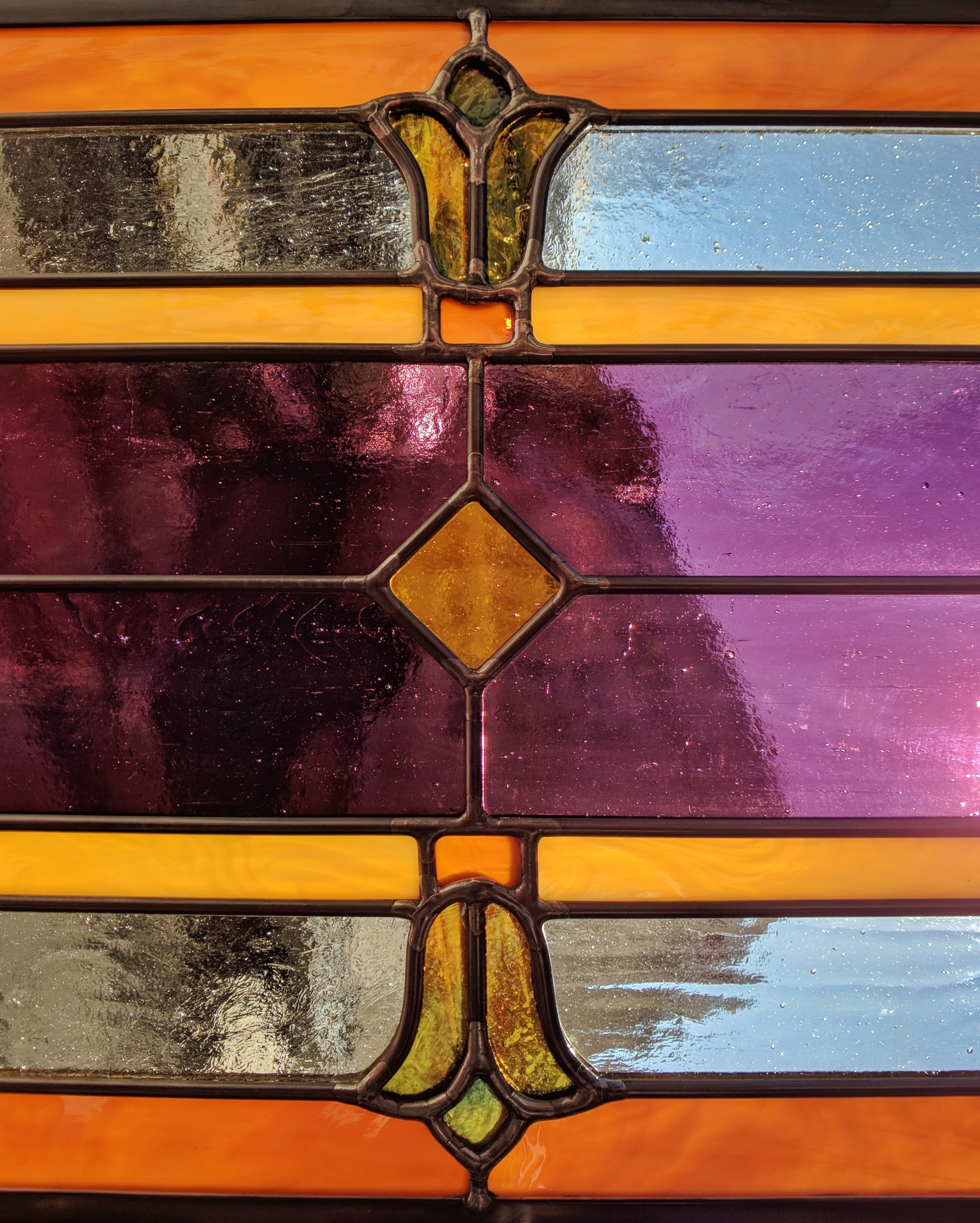 stained glass leaded glass design legacy glass studios menlo park bay area california custom design insulated window tulip uroboros multicolored glass amber close up.jpeg