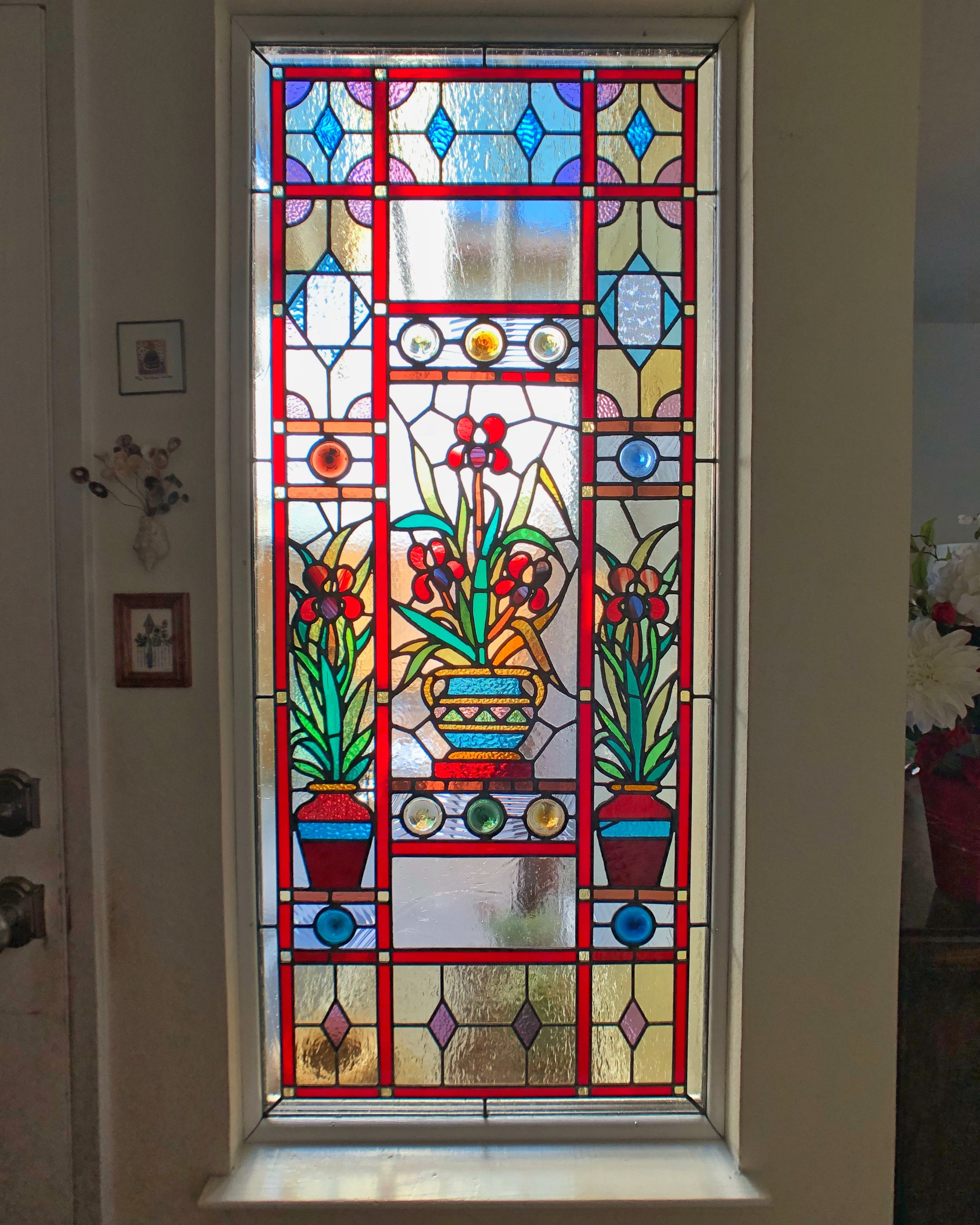 stained glass restoration british charm rondel floral before and after leaded glass legacy glass studios california front entry sidelight colorful custom glass repair front view.jpg