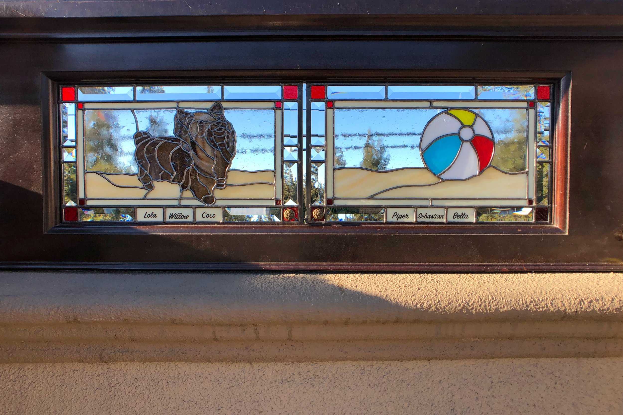 custom backlit stained glass dog at beach ball name plates yorkie terrier legacy glass studios player piano door beveled spectrum glass whimsical.jpg