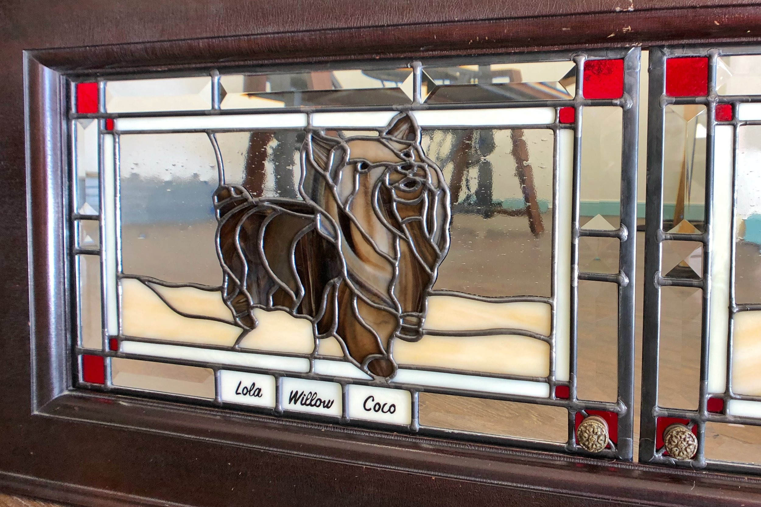 A repeat client of ours has a fun collection of restored player pianos. With these custom piano doors, she wanted to honor her SIX Yorkshire Terriers. We designed a yorkie with the 6 initials hidden in the puppy pieces, and also custom-painted 6 name-plates for her leaded glass piano doors. (See the full design on the Nature Scenes tab.)