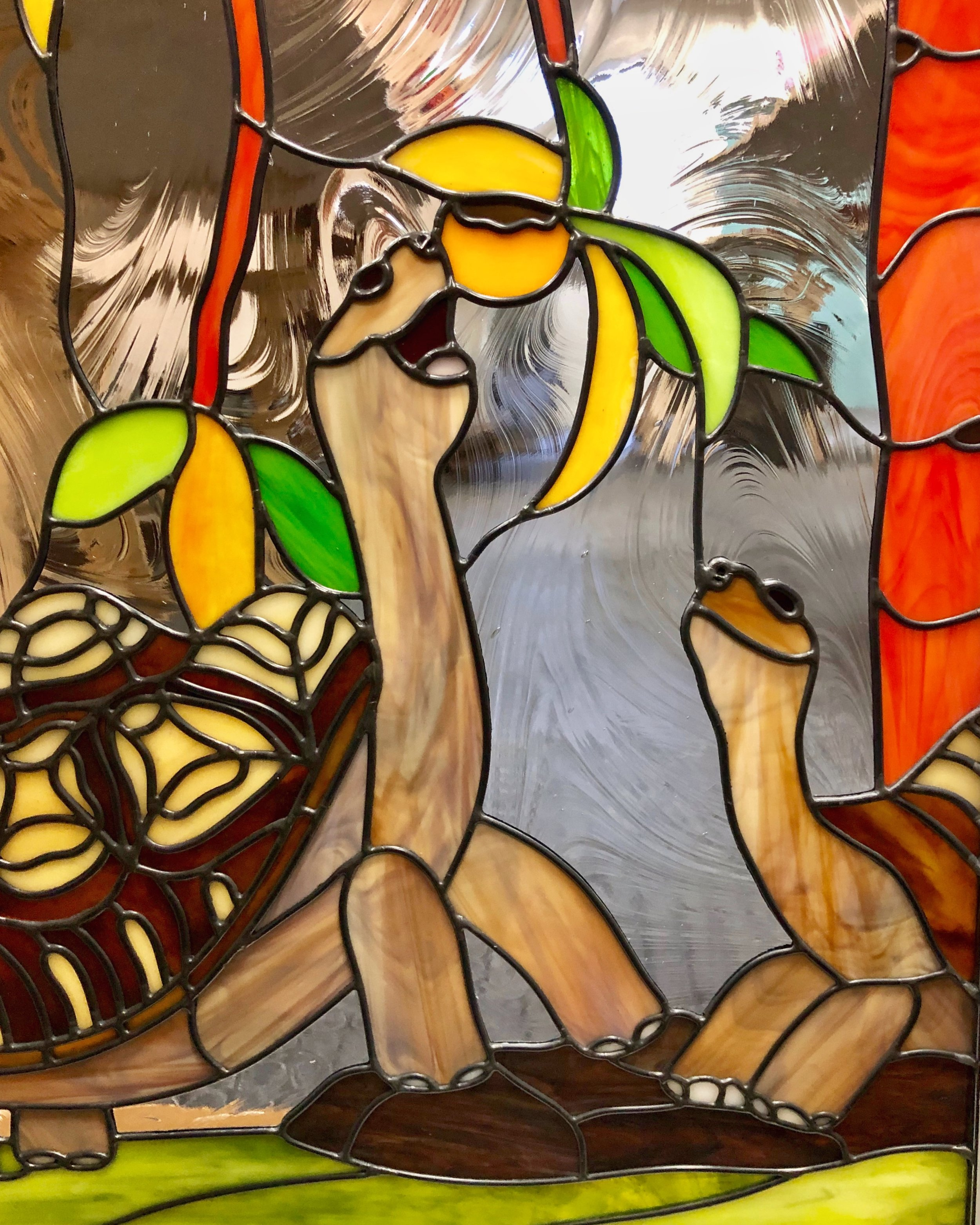 The same client with the piano collection has 2 pet tortoises in her backyard. Our latest project with her honors their backyard oasis by depicting the two tortoises in their patio window. (See the full design on the Nature Scenes tab.)