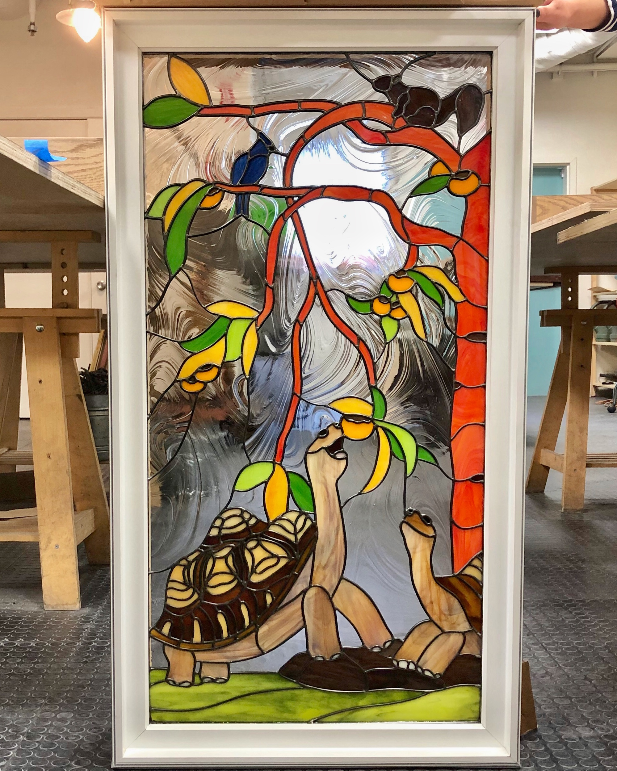 leaded glass stained glass san francisco art glass bay area custom design stained glass legacy glass studios design tortoise turtle tree birds persimmon leaves squirrel baroque green yellow orange pets realistic animals rock grass scene .jpg
