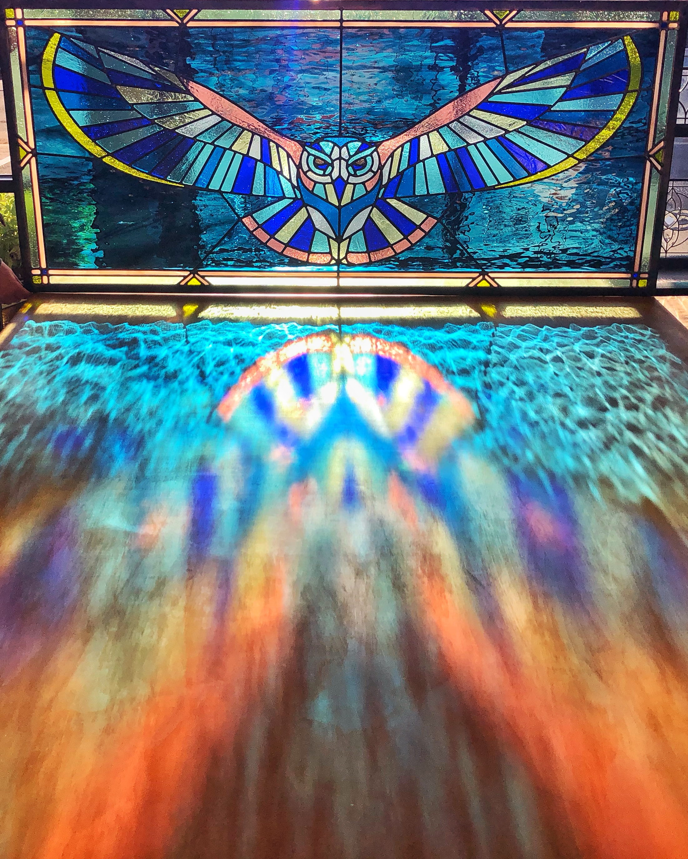 leaded glass stained glass san francisco art glass bay area custom design stained glass legacy glass studios woodside owl cathedral glass water glass opalescent glass eye feather symmetry blue pink green transom animal nature wingspan border.jpg