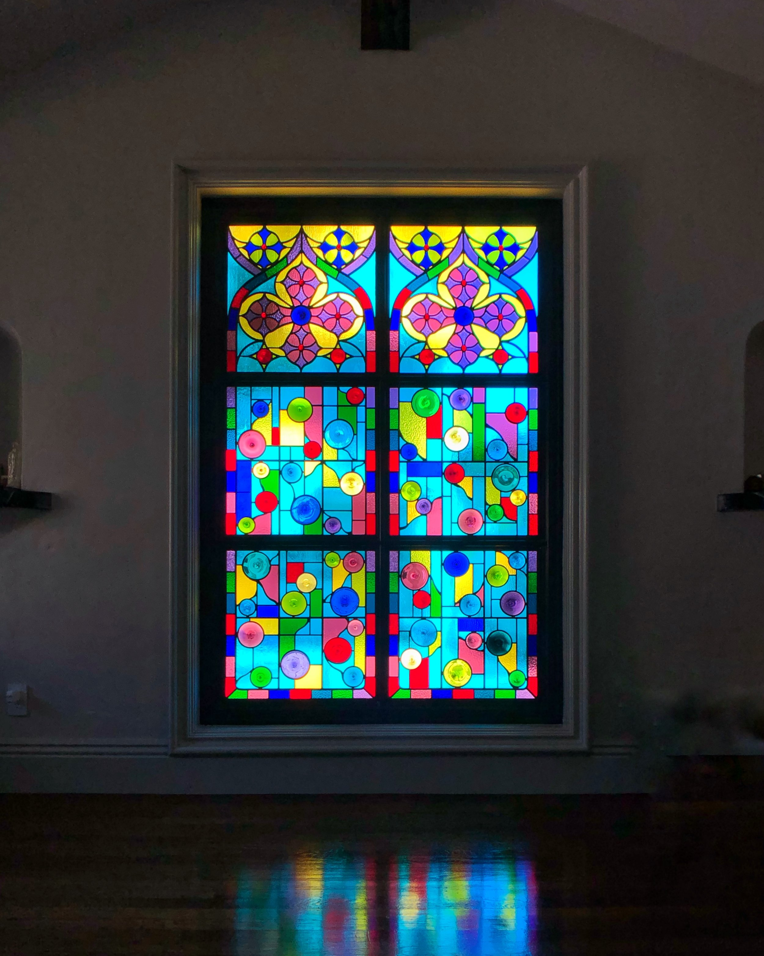 cathedral window st dominics catholic church gothic arch colorful french design stained glass legacy glass studios custom leaded glass wissmach kokomo mouth blown spun rondels privacy window family room reflection.jpg