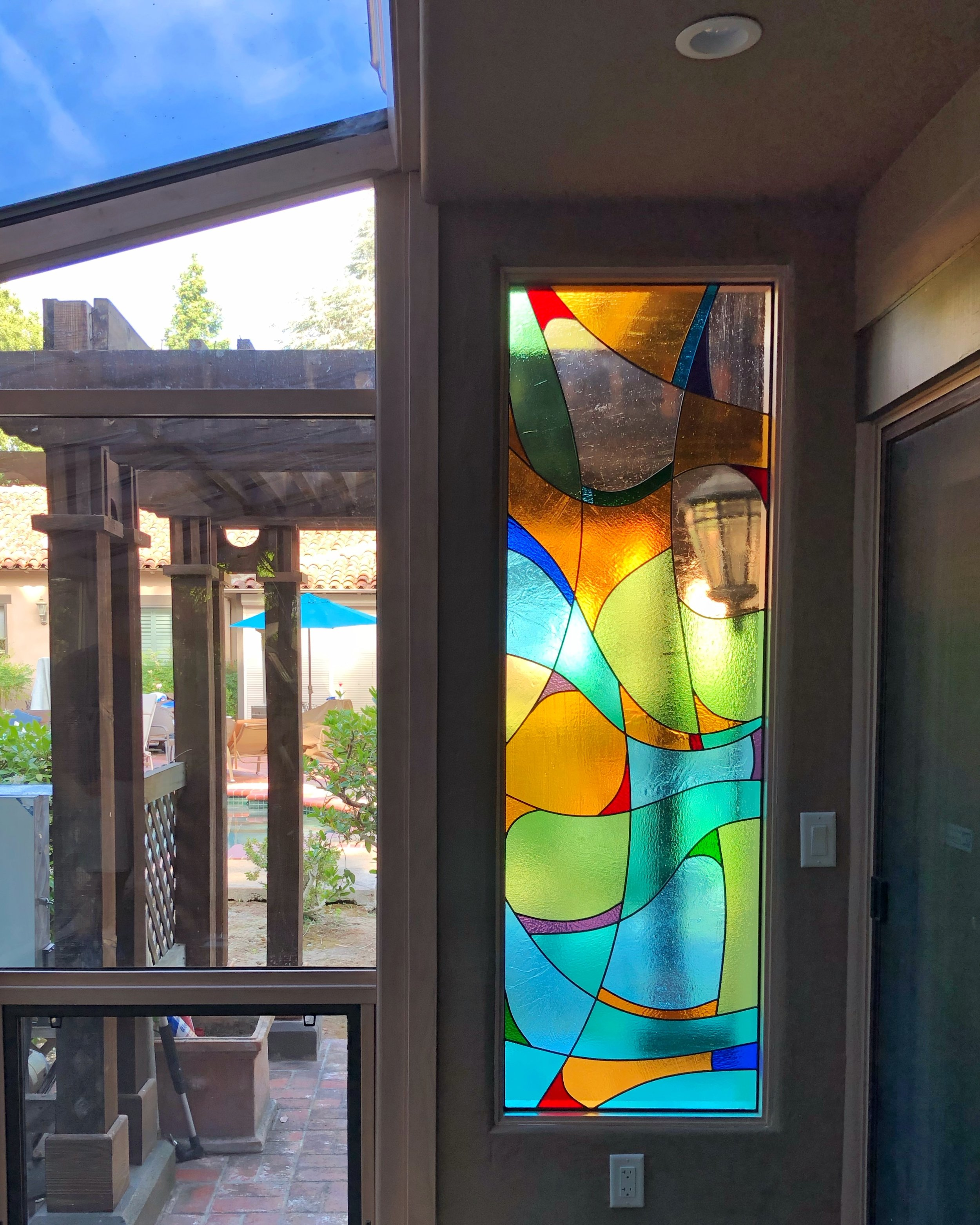 abstract design coloful fun cathedral glass privacy window sunroom pool house atherton california stained glass leaded glass custom design legacy glass studios funky eclectic flowing color block.jpg