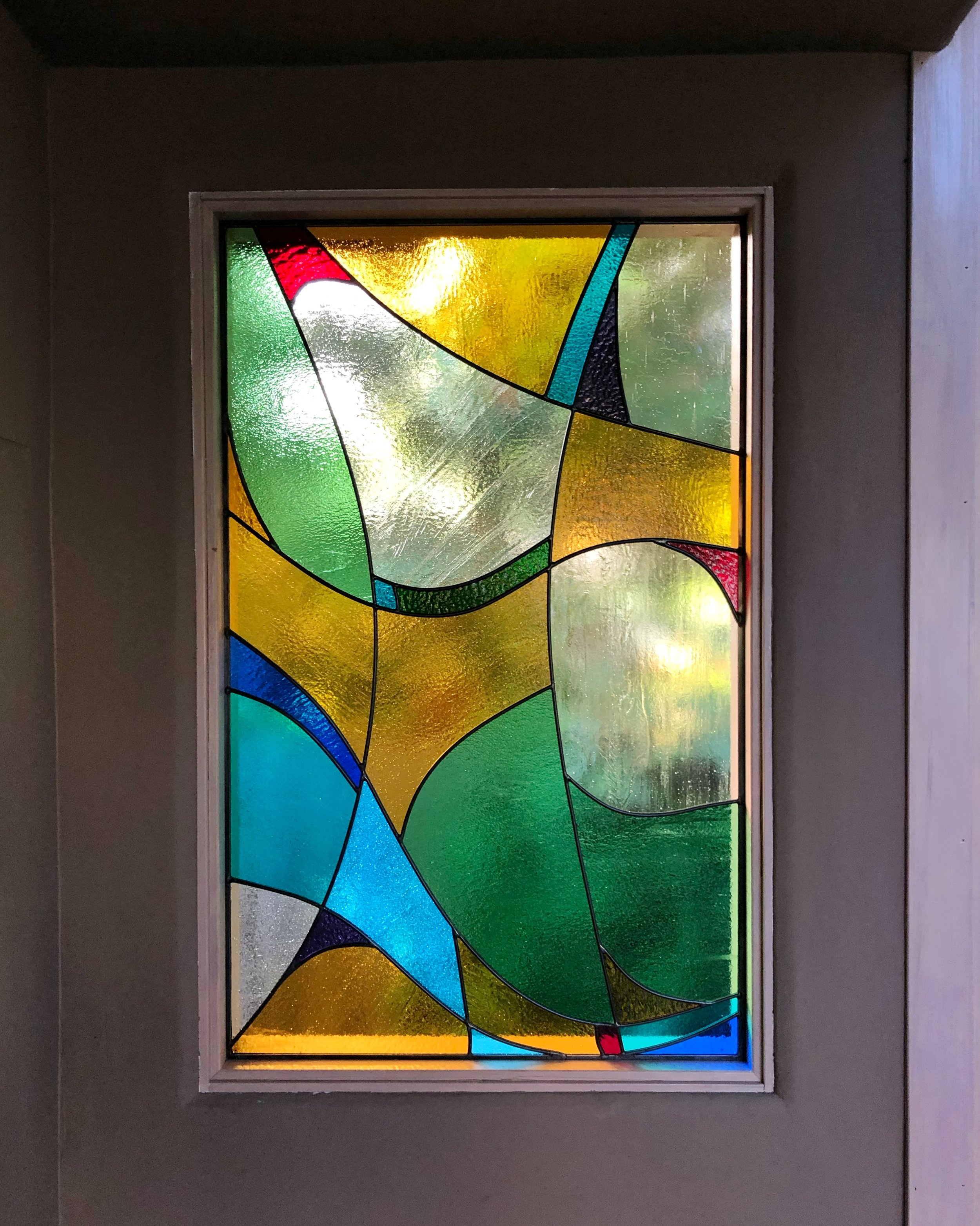 abstract design coloful fun cathedral glass privacy window sunroom atherton california stained glass leaded glass custom design legacy glass studios funky eclectic flowing color block.jpg