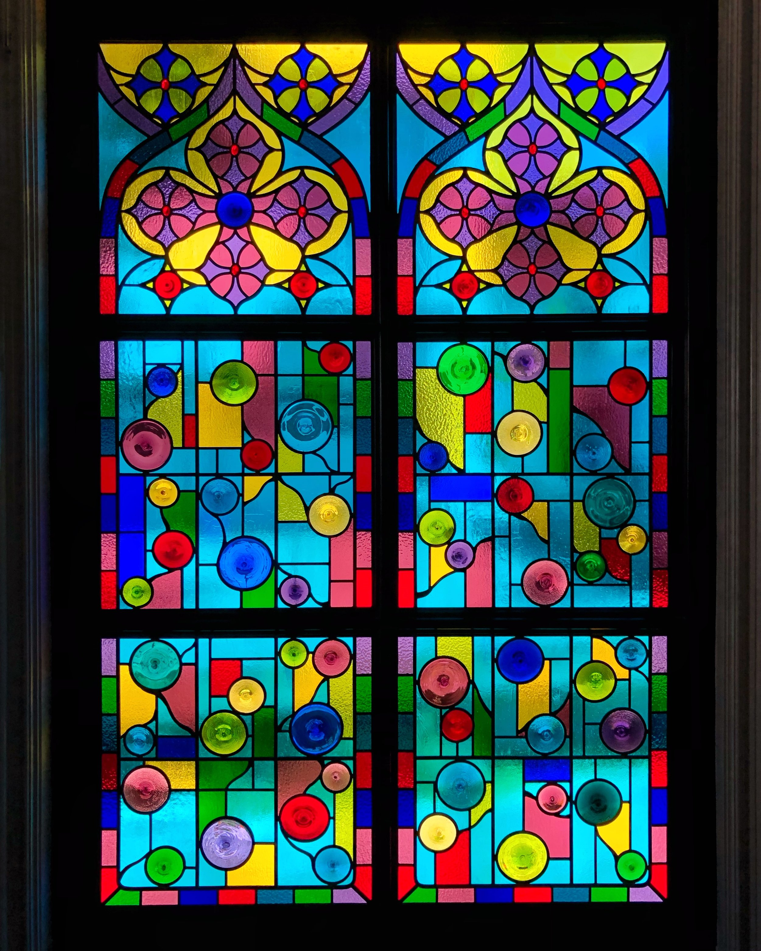 cathedral window st dominics catholic church gothic arch colorful french design stained glass legacy glass studios custom leaded glass wissmach kokomo mouth blown spun rondels privacy window family room.jpg