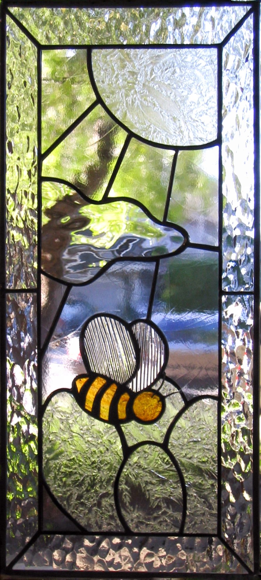 custom stained glass leaded glass bumblebee bee wordplay clear textures obscure privacy glass sunshine cloud nature cut whimsical legacy glass studios.jpg