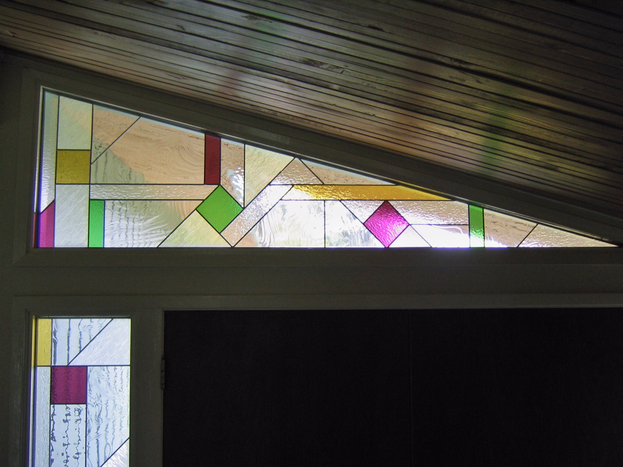 custom stained glass window sidelight insert front entry geometric design art deco midcentury pattern amber purple green clear texture privacy glass legacy glass studios angled transom.jpg