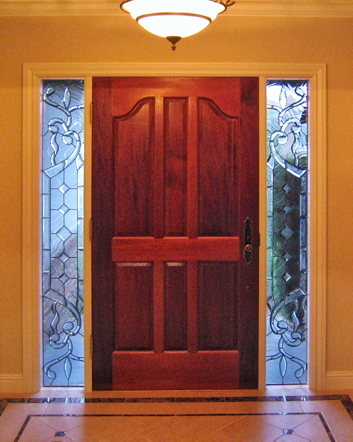 custom leaded glass sidelight inserts window custom bevels bevel cluser diamond glass curved abstract asymmetrical design legacy glass studios privacy obscure clear textured glass.jpg