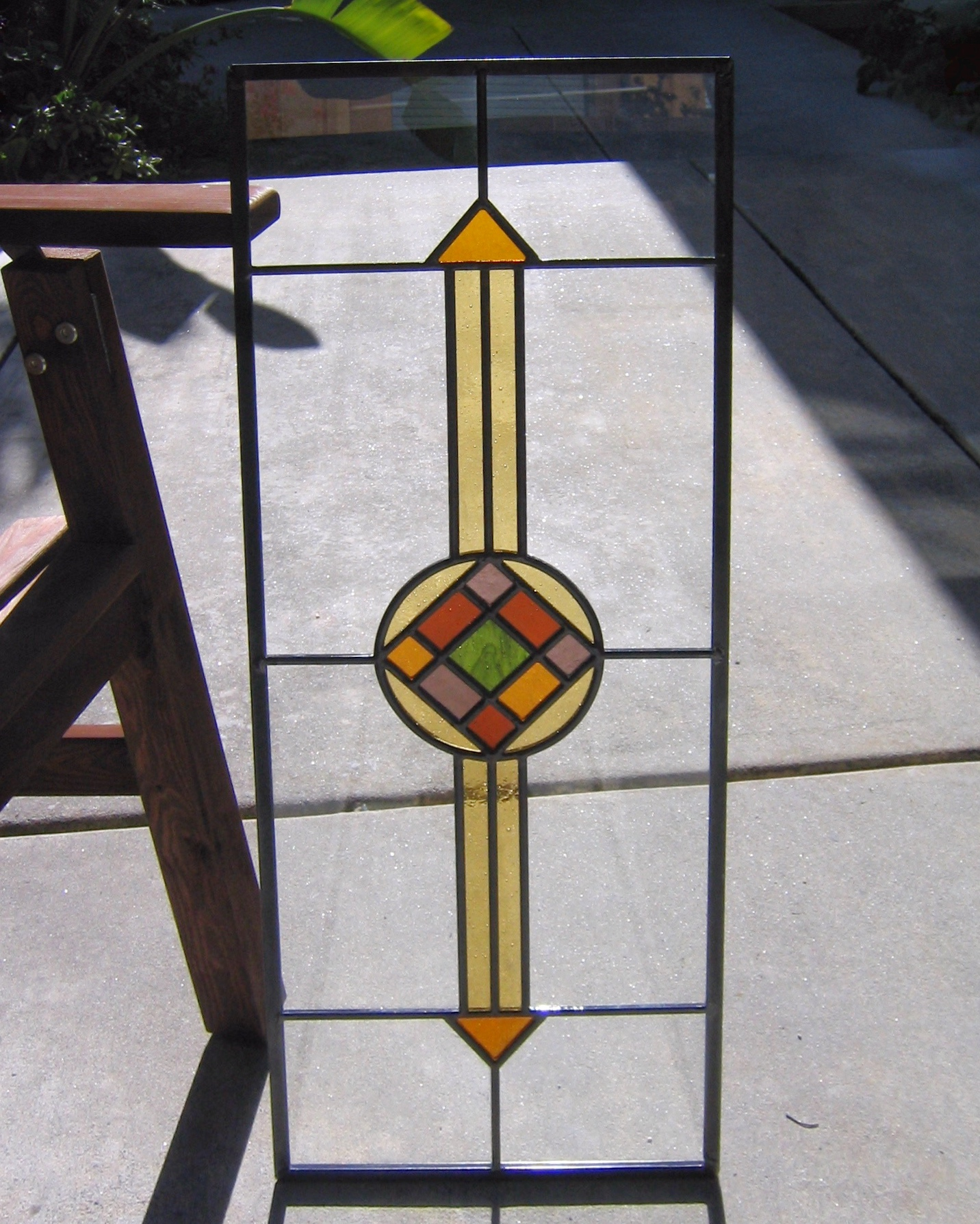 custom stained glass window colorful craftsman linear geometric square diamond medallion pop of color charming character legacy glass studios.jpg