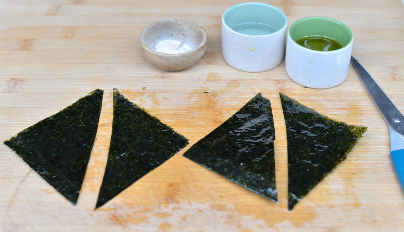 - 1. Preheat the oven to 180°C or 350°F.2. Place the nori sheets on a cutting board or kitchen counter. Prepare two recipients, one filled with water and the other with olive oil.3. Using a pastry brush, lightly brush half the sheet with olive oil. Sprinkle some salt. Fold in two and brush both sides with water (this will make them stick together).4. Cut the sheet in two squares, and each square in two triangles (or do as you like, these chips can be made in any shape)5. Arrange the triangles on a baking sheet and bake for about 15 minutes, until they become dry, crispy and shrivelled. Don't take them out too soon because they might not be crispy enough (you really want the chips to crunch) and watch them closely to avoid burning.6. Serve immediately or let cool on a cooling rack and store in an air-tight container for up to three days.Optional: sprinkle with some sesame seeds before serving.