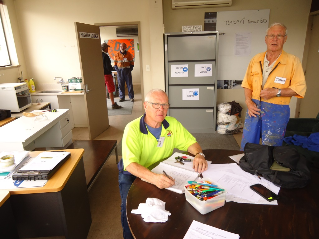 Mark signing the attendance register