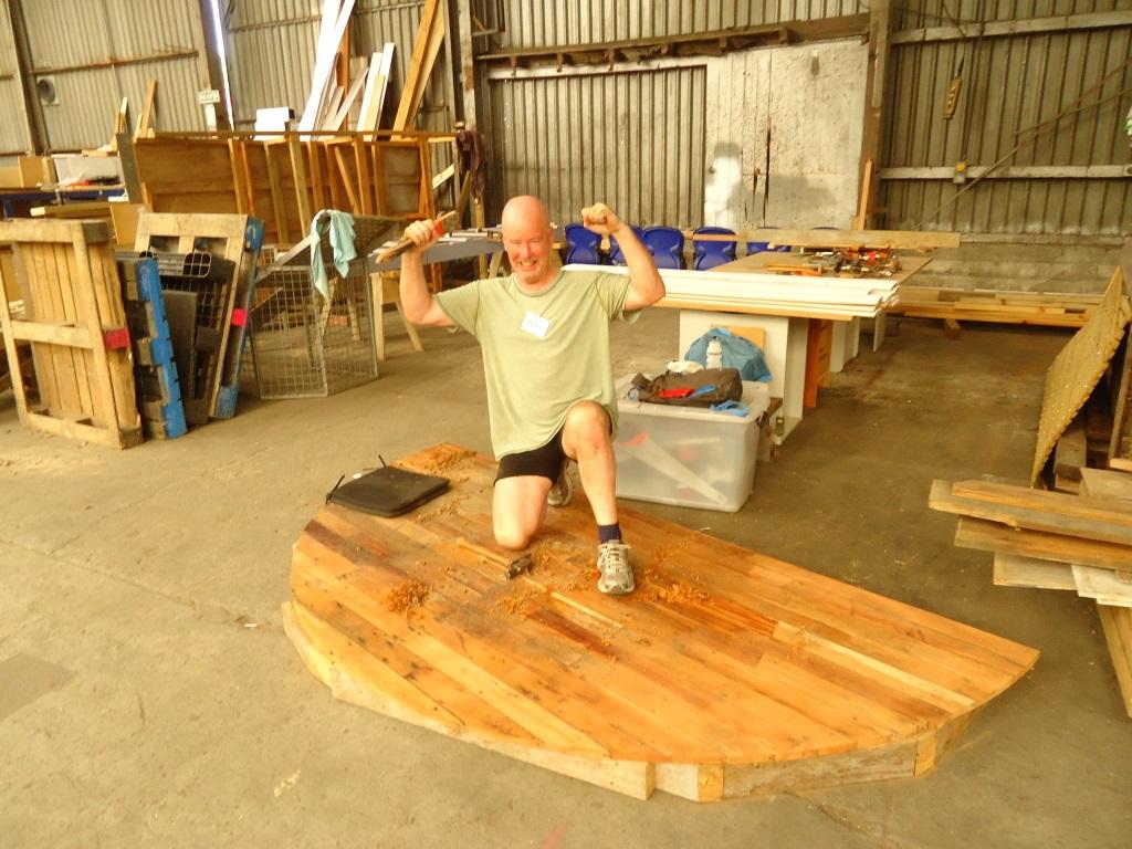 Stephen building a yurt floor.