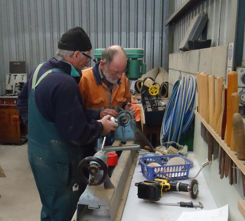 Wayne and Richard setting up a wood lathe.