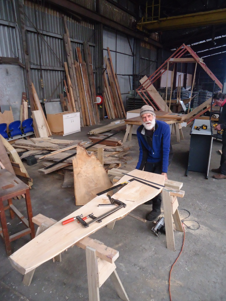 Brian works on a memorial seat.