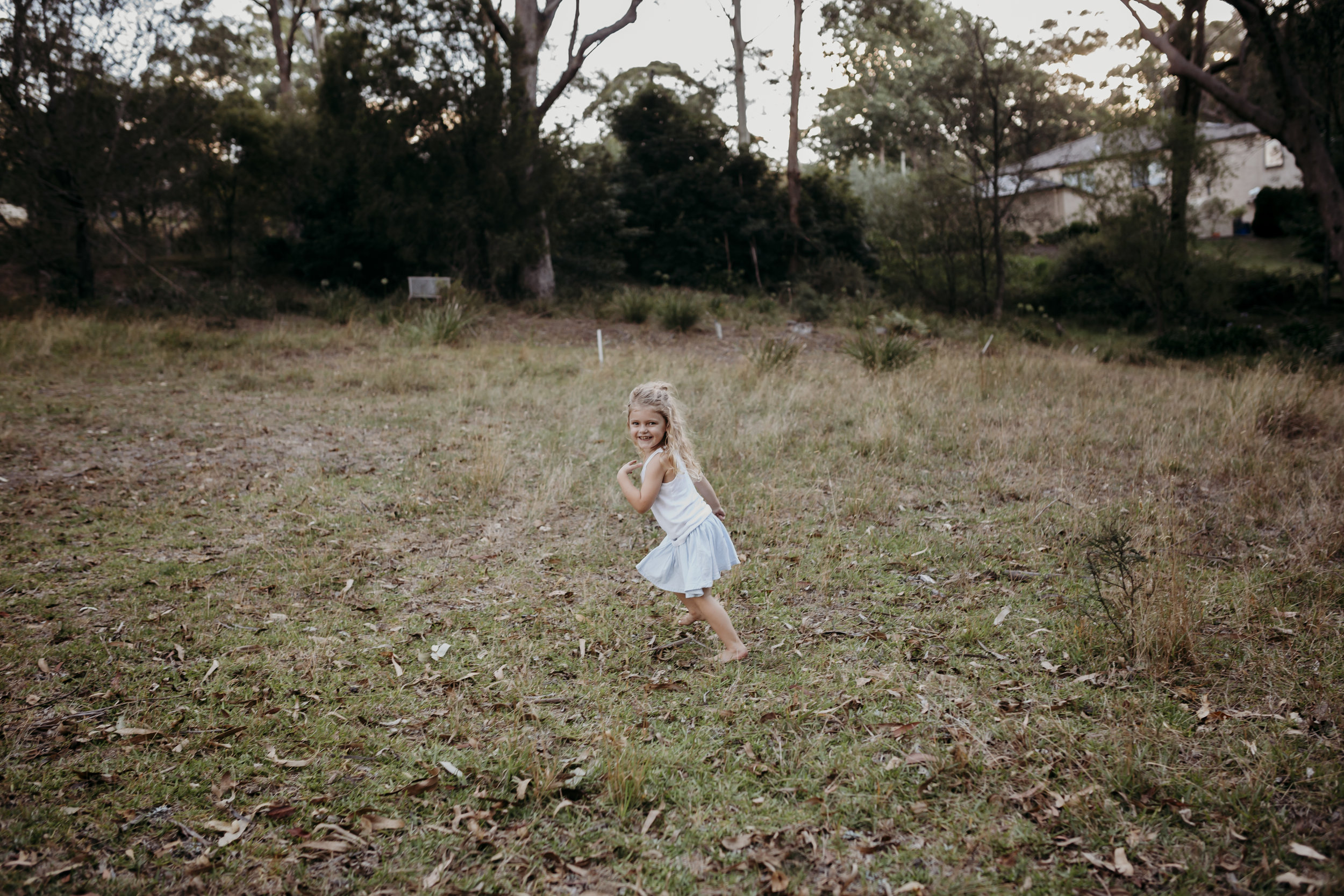 little girl running in bush
