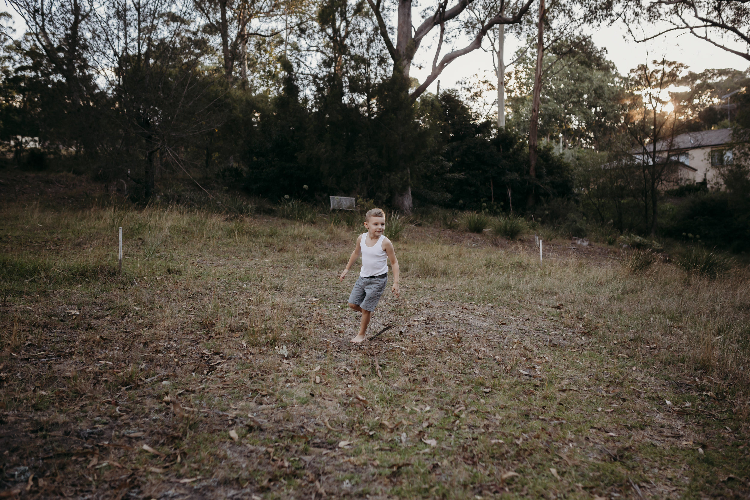 boy running in bush