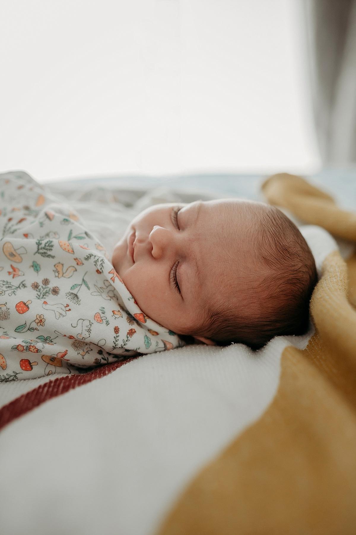 looking along bed at baby asleep