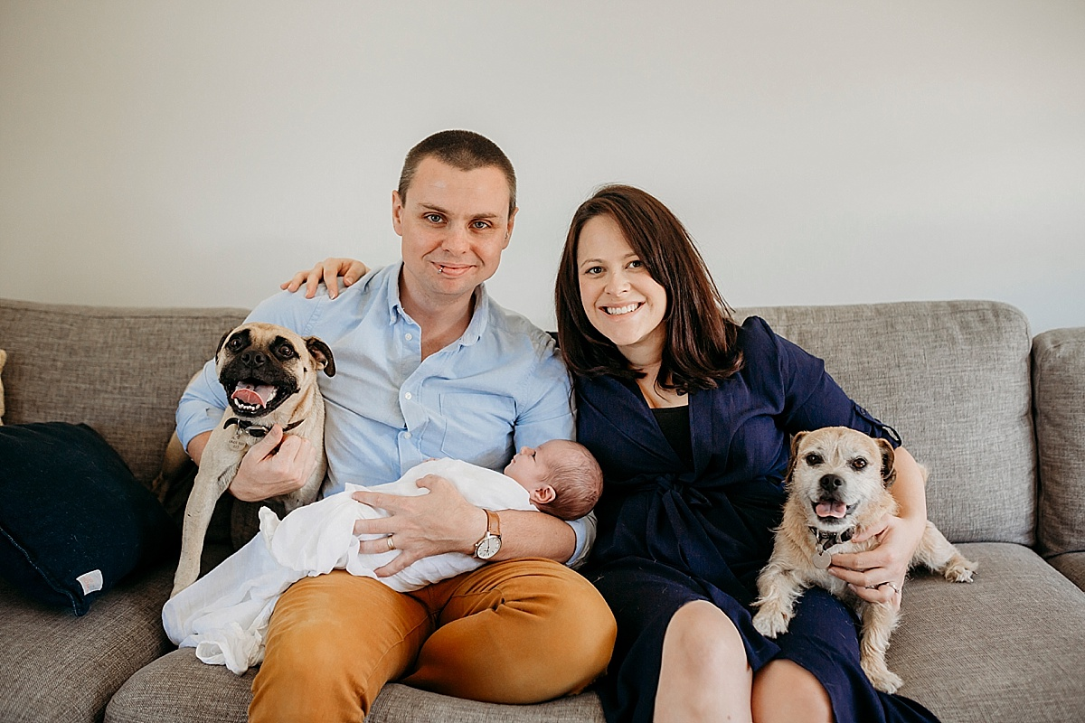 Newborn with mum dad and two dogs on lounge