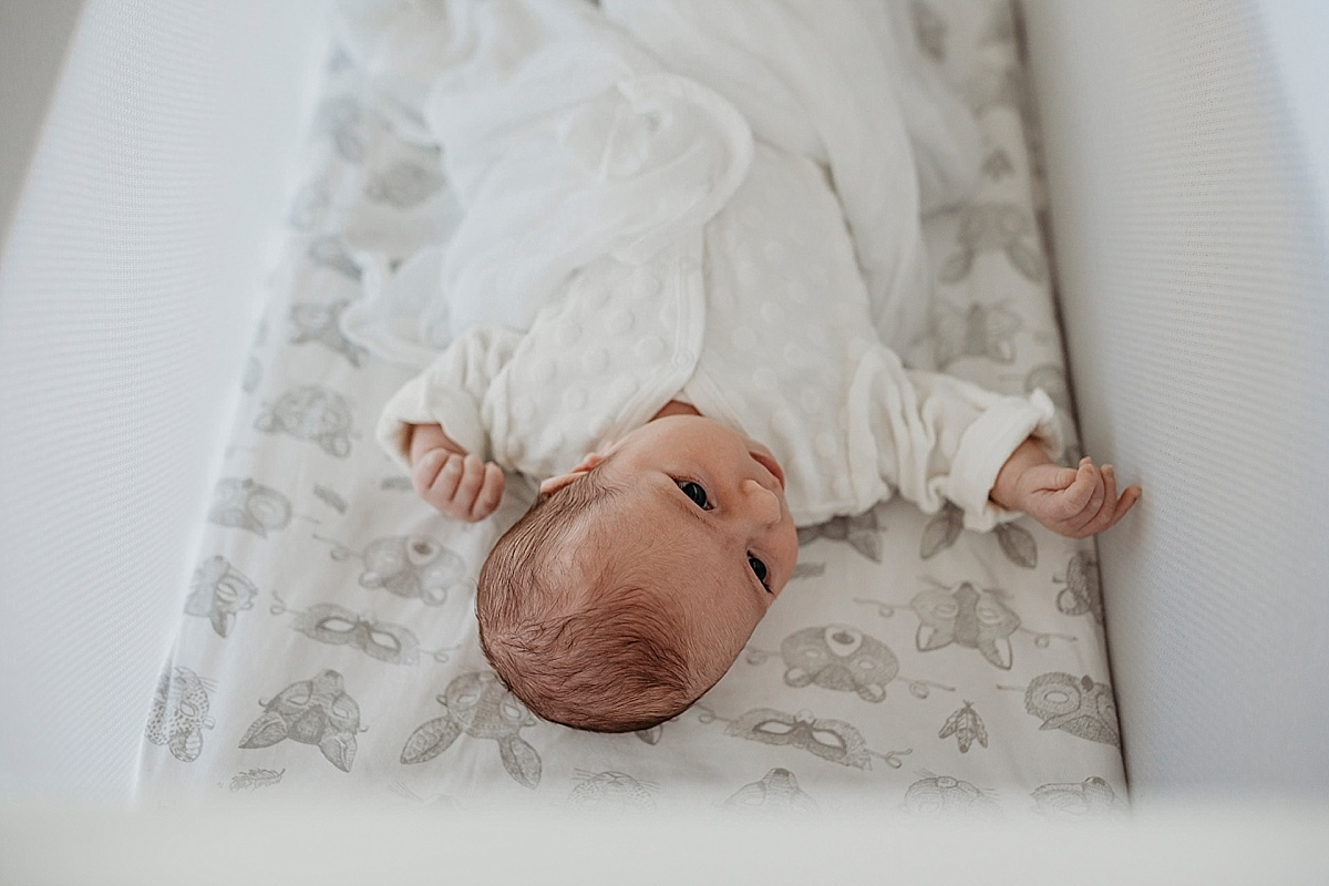 newborn baby in bassinet