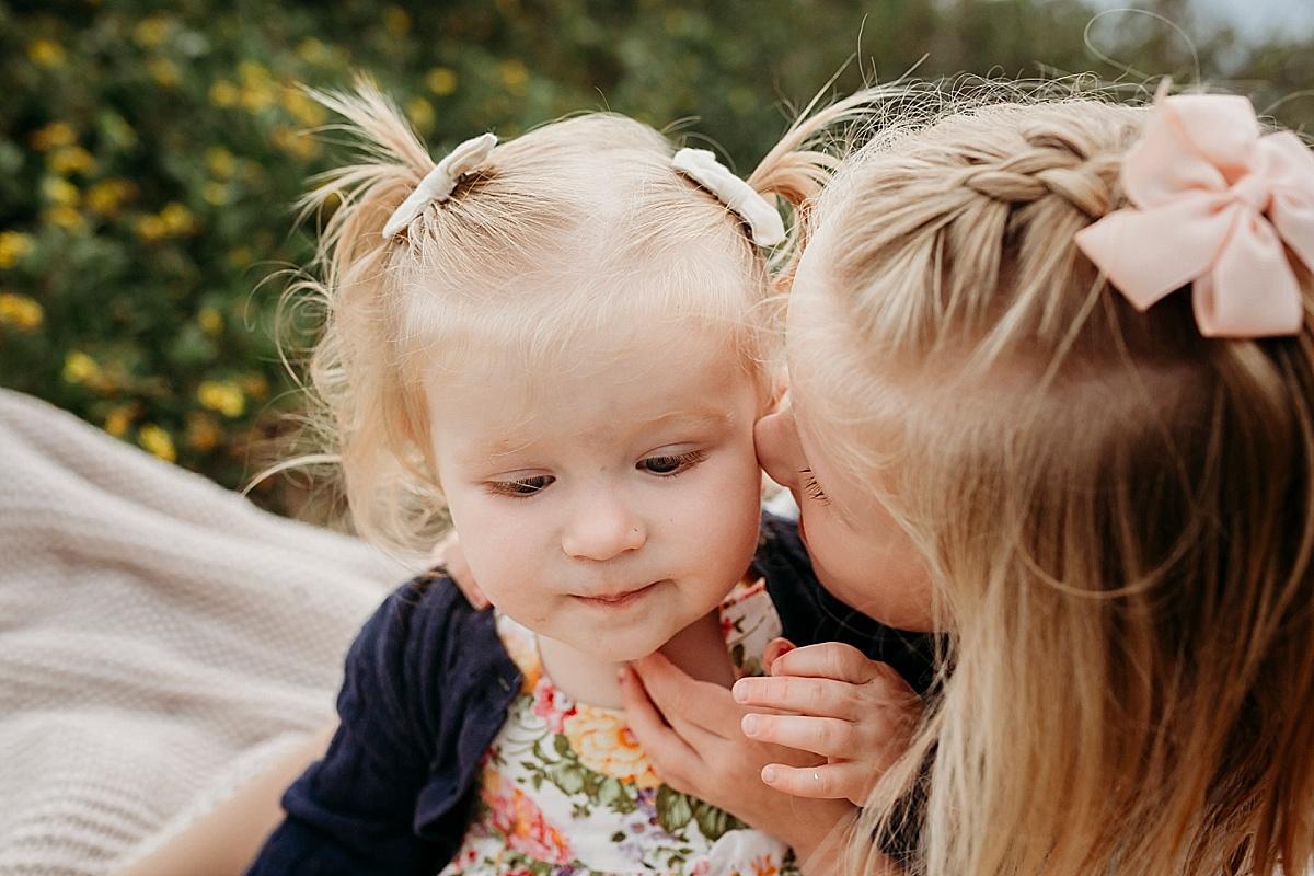 Little girls telling secrets